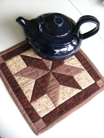 Hand quilted teapot mat and handmade pottery teapot